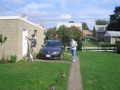 Owen locks his garage while Thad looks on