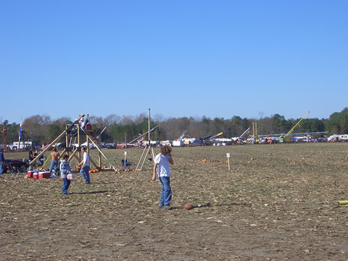 You can just make out the trebuchet that uses people as its weights
