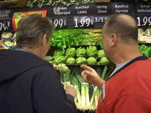 My mom and the produce guy consult about artichokes